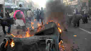 This photo, taken by an individual not employed by the Associated Press and obtained by the AP outside Iran, shows Iranian protestors attending  an anti-government protest as a trash dumpster is set on fire, in Tehran, earlier today (Feb. 14, 2011).