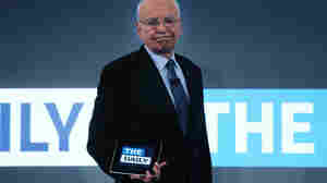 News Corp. CEO Rupert Murdoch walks on stage with an iPad for the Feb. 2 launch of his new online newspaper for the Apple iPad called The Daily.