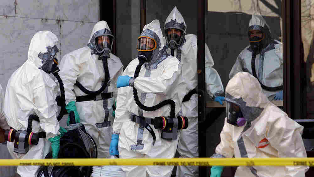 Hazardous materials experts enter the Hart Building of the U.S. Senate on Nov. 7, 2001, in Washington. The building was closed after an anthrax-laced letter was found in then-Sen. Tom Daschle's office.
