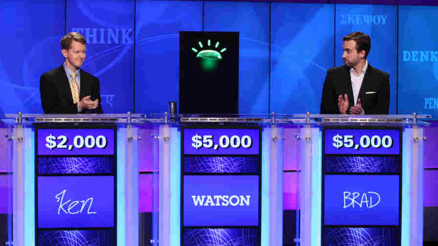 In this undated publicity image, contestants Ken Jennings, left, and Brad Rutter and a computer named Watson compete on Jeopardy!