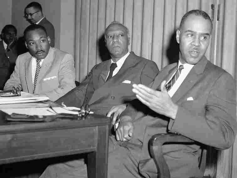 Three civil rights leaders hold a news conference, April 5, 1957, to announce plans for a prayer pilgrimage to Washington on May 17, the third anniversary of the Supreme Court's decision against segregated schools. From left are the Rev. Martin Luther King Jr., A. Philip Randolph and Roy Wilkins.