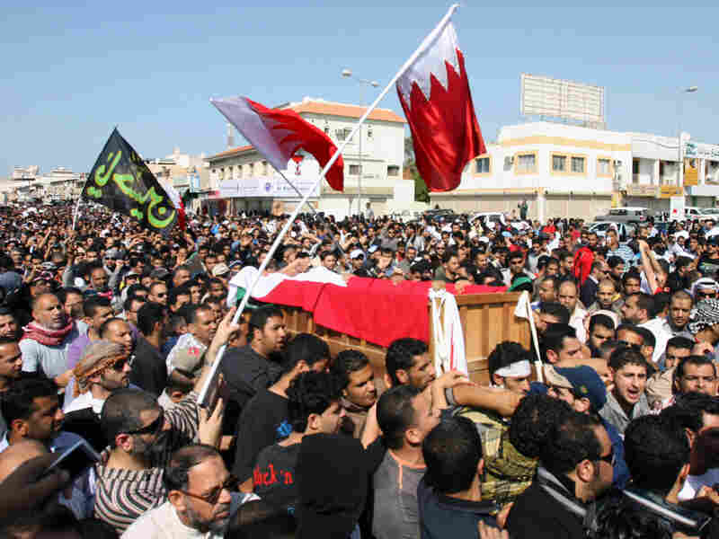 Shiite protesters at a funeral Tuesday in Bahrain carry the coffin of a man who died after clashes with police in the town of Jidhafs.