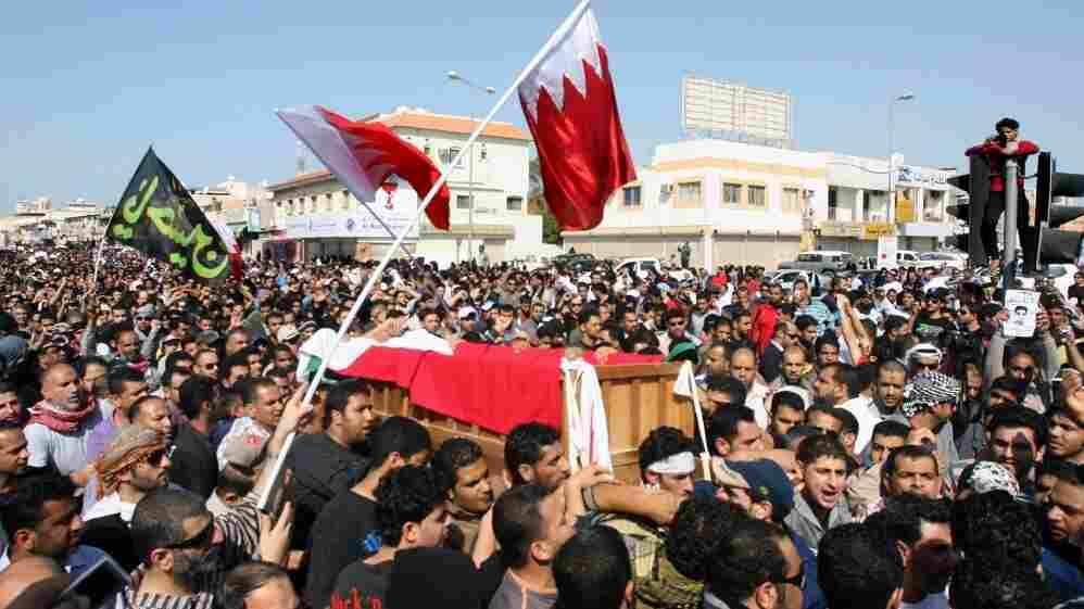 Bahraini Shiite protesters at a funeral Tuesday carry the coffin of a man who died a day earlier from his wounds after clashes with police in the town of Jidhafs.