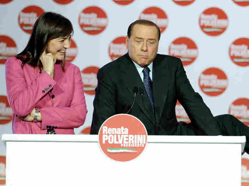 Italian Prime Minister Silvio Berlusconi speaks at a support rally for the Party of Freedom (PDL) presidential candidate Renata Polverini in Rome last year. A judge has ordered the Italian leader to face trail on charges that he paid a minor for sex.