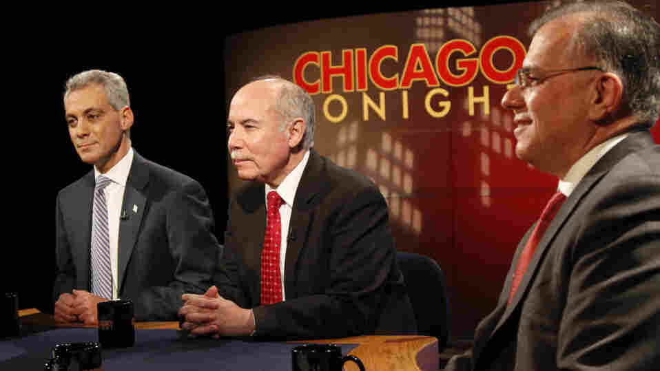 Mayoral candidates (from left) Rahm Emanuel, Miguel del Valle and Gery Chico wait for the start of Monday's debate at the WTTW television studios in Chicago. The fourth candidate, Carol Moseley Braun, arrived later.