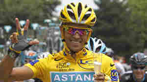 July 25, 2010: Alberto Contador of Spain flashes three fingers for his third Tour de France victory.