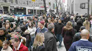 Crowds pack a New York sidewalk days before Christmas in 2006.