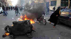 A garbage container burned during protests Monday (Feb. 14, 2011) in Tehran.