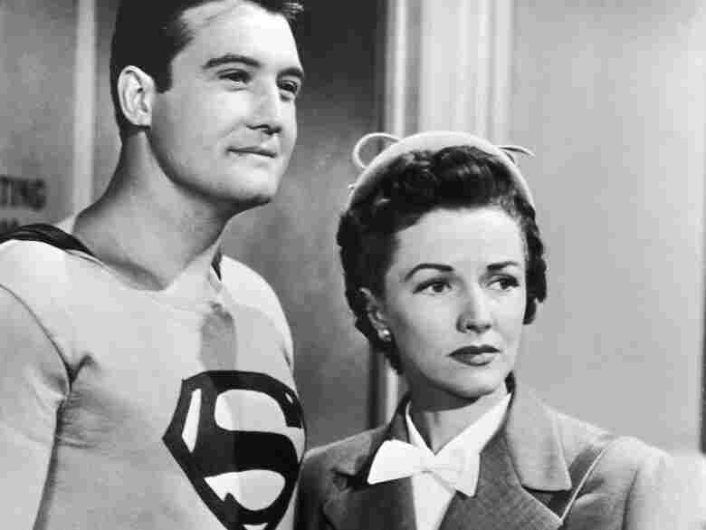 American actor George Reeves as Superman stands with Phyllis Coates, as Lois Lane, in a still from the television series 'Adventures of Superman,' circa 1952.