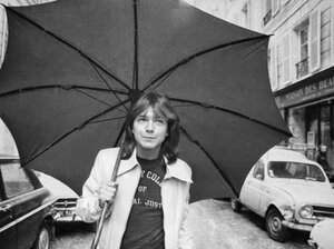 David Cassidy, star of the television show The Partridge Family, walks down a road in London in 1974. Allison Pearson's new novel I Think I Love You tells the story of a teenage girl in love with the American pop singer.