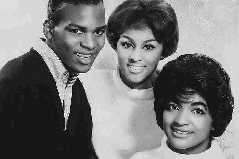 The daughter of a Pentecostal minister, Love (center) grew up in Los Angeles with three siblings. She began singing in the church choir as a teen.