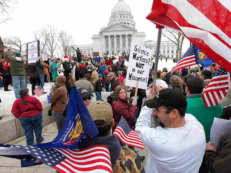 Demonstrators gather on the grounds of the Wisconsin state Capitol building on Tuesday.