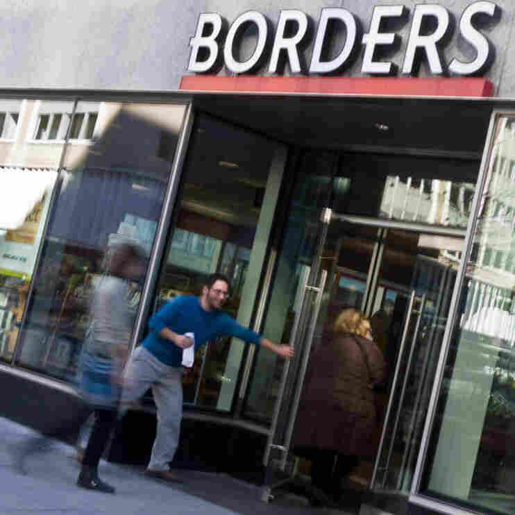 People enter a  Borders bookstore in Washington, D.C.,  on Monday.