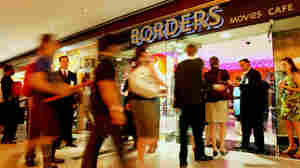"""Harry Potter fans enter Borders at Time Warner Center to purchase their copy of the book """"Harry Potter And The Deathly Hallows"""" on July 20, 2007, in New York City. Two hundred Borders stores will close soon as part of the company's Chapter 11 filing."""