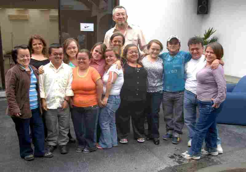 Jaime Guevara-Aguirre stands with  some of the people who took part in his study of Laron syndrome in Ecuador.