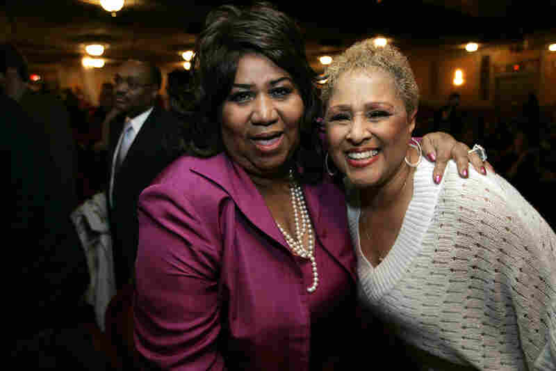 "Aretha Franklin (left) poses with Love, at the time a cast member of the Broadway show ""Hairspray,"" in 2007. Once established, Love took Phil Spector to court for a share of the royalties owed to her from the '60s — and won."