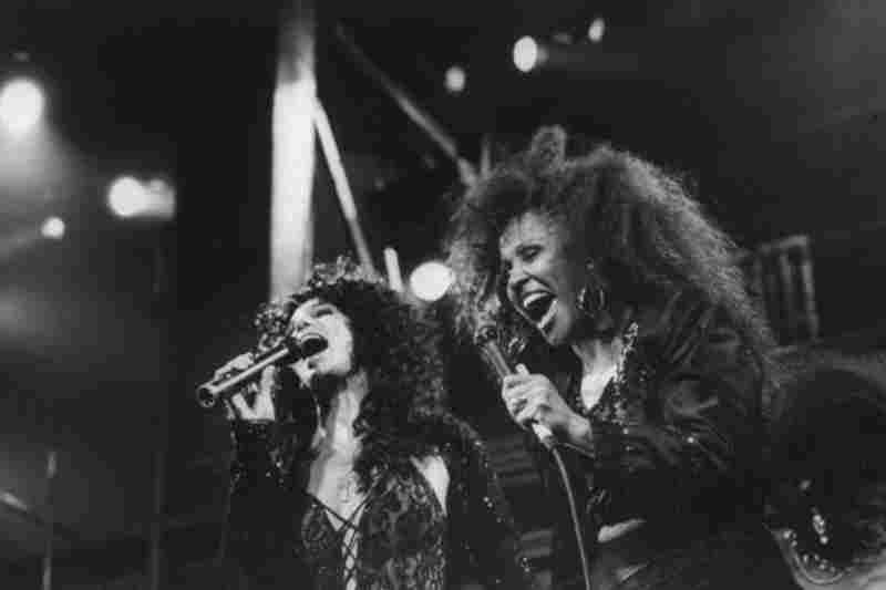 Love performs with Cher at Fox Theater in 1989. After hitting rock bottom taking up work as a house cleaner, Love made her way back to the stage preforming in New York and Los Angeles and singing backup vocals for Cher and U2.