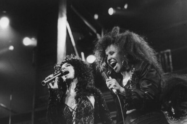 Love performs with Cher at Fox Theater in 1989. After hitting rock bottom taking up work as a house cleaner, Love made her way back to the stage preforming in New York and Los Angeles and singing backup vocals for Cher and U2.  (Getty Images)