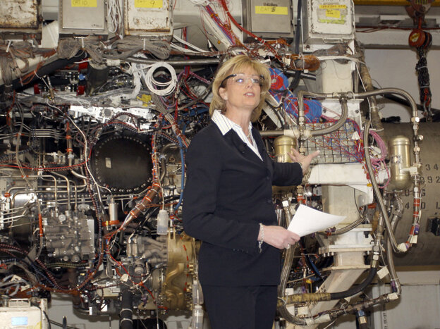 GE Aviation's former president, Jean Lyndon-Rodgers, in 2009, showing off the joint strike fighter engine in Evendale, Ohio.