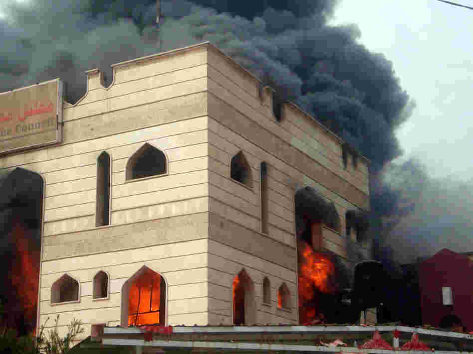 Flames engulfed an Iraqi government building in the southern city of Kut after it was set on fire by protesters demanding the provincial governor's resignation.