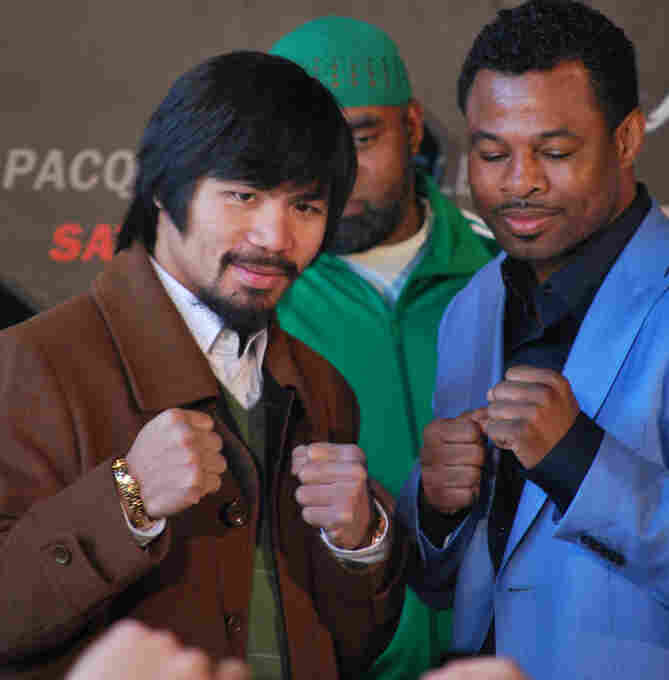 "Manny ""Pacman"" Pacquiao and ""Sugar"" Shane Mosley pose after a New York press conference for their upcoming May 7 fight."