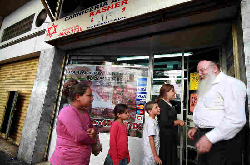 Abraham Jafif, 61, owner of Chamen, a kosher butchery, welcomes clients in Buenos   Aires' Once neighborhood, home to many Orthodox Jews. Jafif says that the Argentine government's decision to recognize the Palestinian state is an act of anti-Semitism.