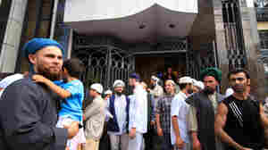 A group of Muslims leave the Al Ahmad mosque, the most popular in Buenos Aires, after Friday prayers on Jan. 28. Many say they are satisfied with the government's decision to recognize a Palestinian state.