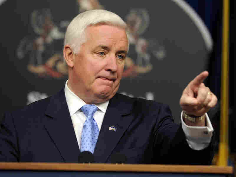 Pennsylvania Gov. Tom Corbett fields media questions during a news conference on Tuesday in Harrisburg.  He said he's removing a number of state employees as a result of an investigation into a Philadelphia clinic where abortions were performed.