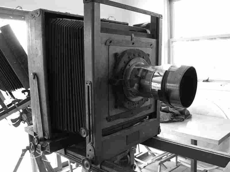 Sally Mann shoots with antique view cameras from the early 1900s, the kind where you duck under a cloth to take the picture. They have hulking wooden frames, accordion-like bellows and long brass lenses held together with tape, with mold growing inside.