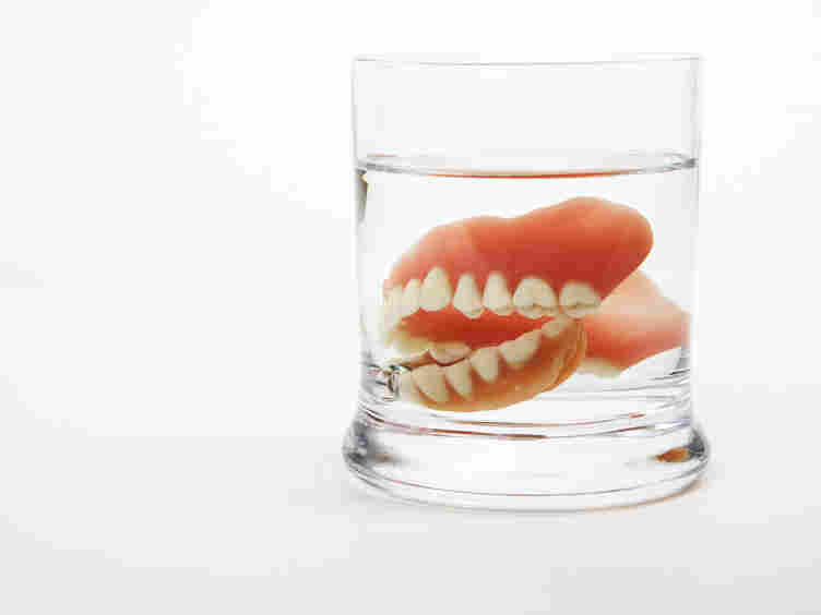 Dentures in a glass.
