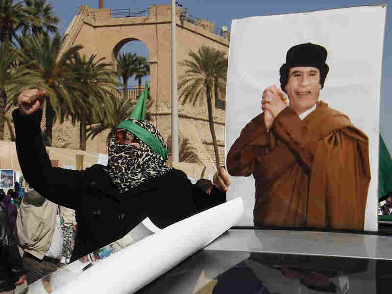 A supporter of Libyan leader Moammar Gadhafi took part in a pro-government rally Thursday in Tripoli.