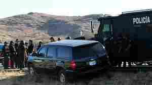Mexican police guard the U.S. vehicle that