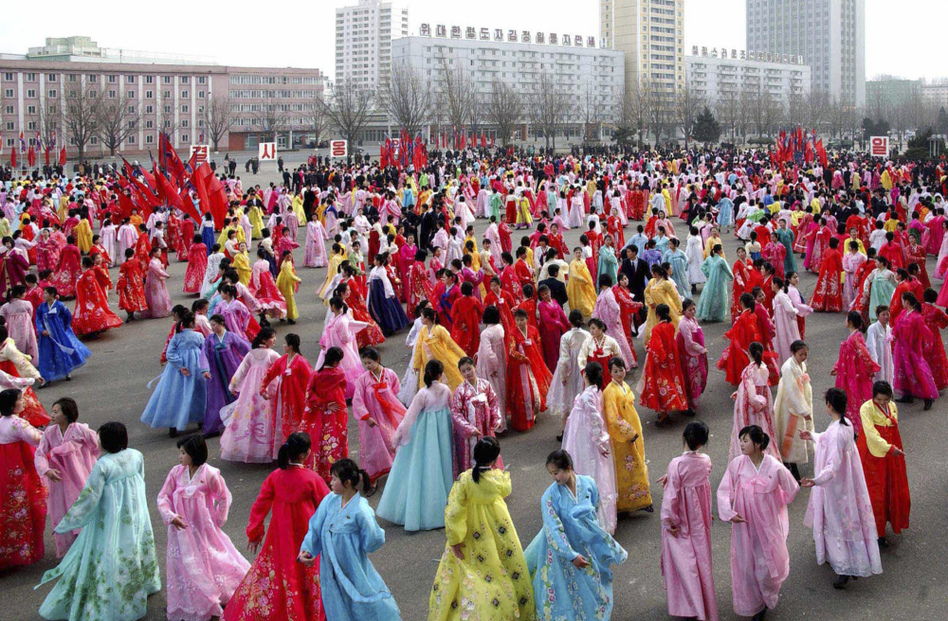 North Korean students dance to celebrate the 69th birthday of their leader, Kim Jong Il, in the North Korean capital of Pyongyang.