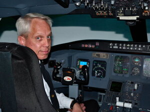 Flight instructor Tom Peterson uses a simulated Canadair Regional Jet  flight deck at Embry-Riddle Aeronautical University to teach pilots how to fly a modern aircraft, which relies heavily on computer automation.