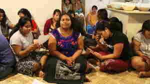 At a party outside Brisbane, Australia, nursing students sing i-Kiribati songs.