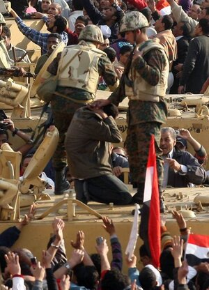 Egyptian soldiers detained this anti-government demonstrator in Cairo's Tahrir square on Feb. 2, 2011.