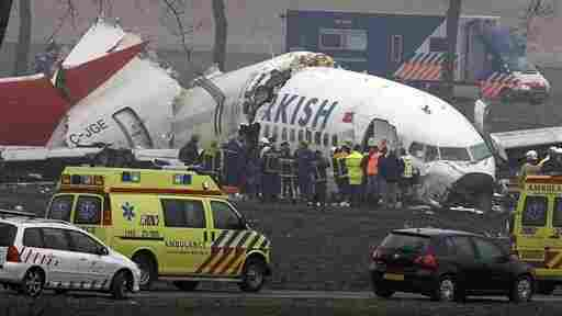 The wreckage of a Turkish Airlines aircraft after it slammed into a field while attempting to land at Amsterdam's Schiphol Airport. The NTSB found that the Boeing 737's automatic throttles were getting the wrong altitude information and the flight's first officer pushed the automation buttons in the wrong order.