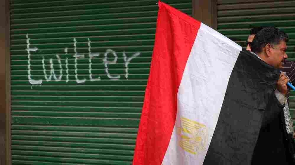 """A shop in Cairo's Tahrir Square is spray-painted with the word """"twitter"""" on Feb. 4, days after the  Egyptian government blocked Internet access."""