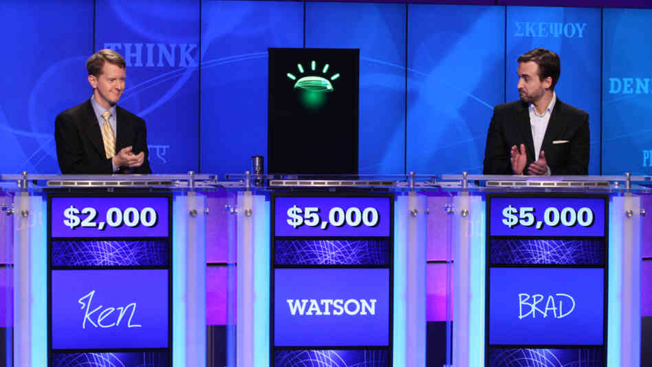 Ken Jennings, left, and Brad Rutter, right, applauded for Watson earlier in the competition.