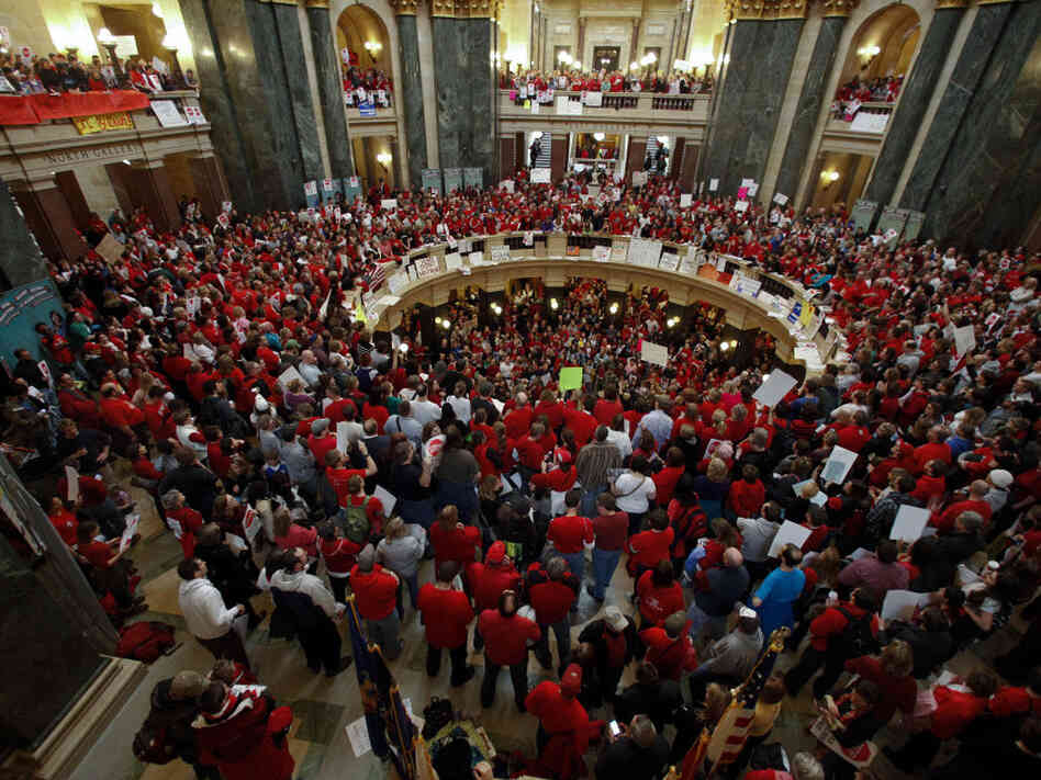 Protesters fill the Wisconsin Capitol in Madison on Thursday to protest Gov. Scott Walker's bill to eliminate collective bargaining rights for many state workers.