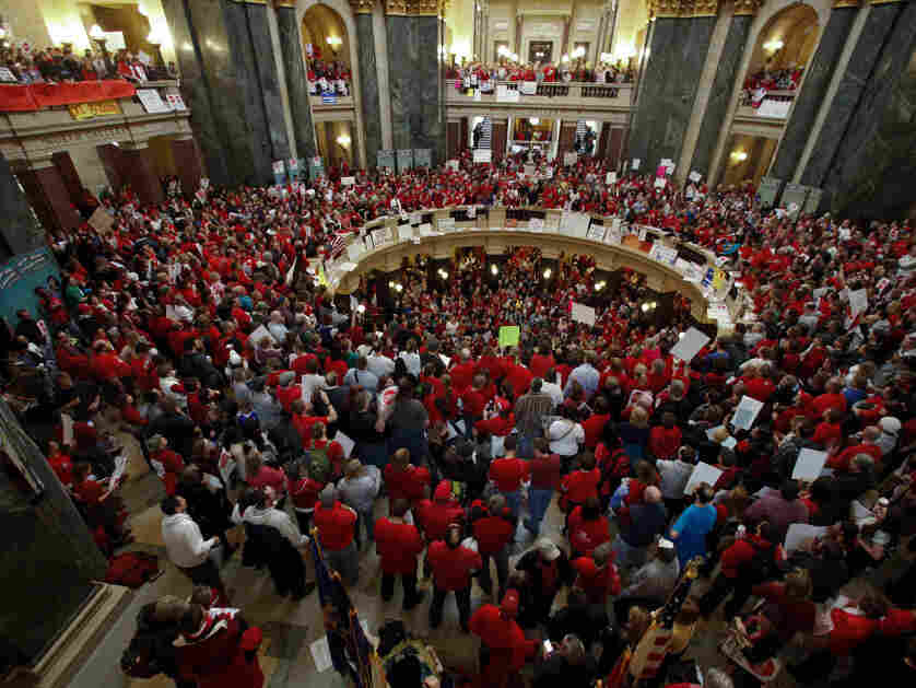 Demonstrators jam Wisconsin's state capitol to protest a Republican bill to reduce public worker bargaining rights and take home pay.