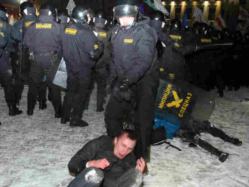 Protesters clash with riot police during a rally in Minsk on Dec. 20. Tens of thousands of protesters rallied against elections swept by President Alexander Lukashenko.