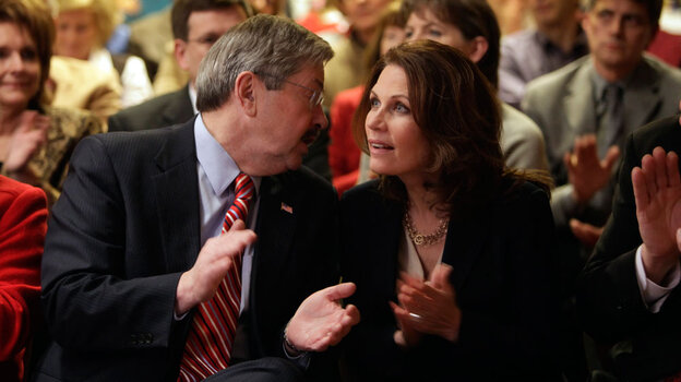 Iowa Gov. Terry Branstad talks with Rep. Michele Bachmann  (R-MN) at a reception in Des Moines in January.
