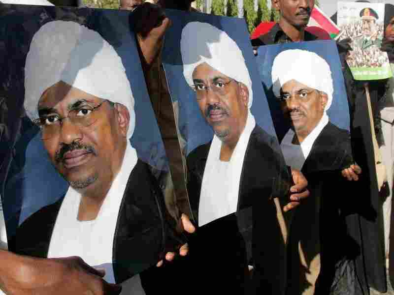 Sudanese demonstrators hold portaits of President Omar al-Bashir during a protest in Khartoum in 2009. Some argue that the fall of former President Hosni Mubarak in Egypt could severely weaken Sudan's already vulnerable government.