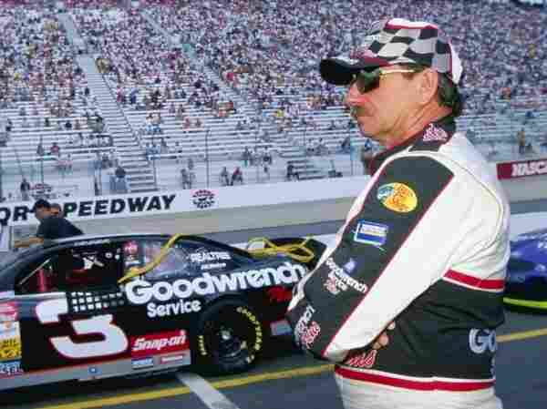 Dale Earnhardt, in front of his No. 3 car, looks on during practice for the Ford City 500 in 1999. Earnhardt was killed in a crash in the last lap of the Daytona 500 on Feb. 18, 2001.