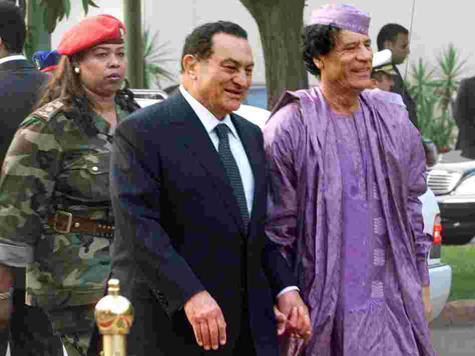 Libyan leader Moammar Gadhafi (right) is welcomed by then-Egyptian President Hosni Mubarak upon his arrival at the Presidential Palace in Cairo on July 21, 2002.