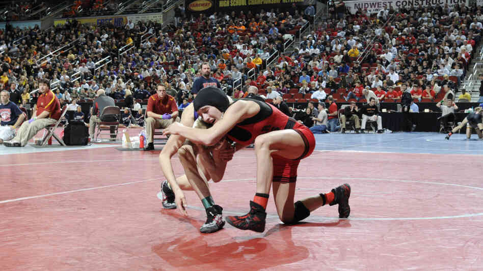 Cedar Falls' Cassy Herkelman, right, wrestles with Indianola's Matt Victor in a Class 3A 112 pound quarterfinal match.