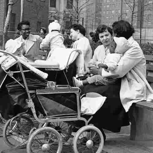 The rate of integration has slowed in recent decades, according to demographers. Here, white and black mothers chat as they enjoy the sun at the Alfred E. Smith housing development in New York, May 1956.