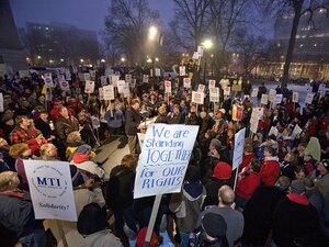 Protesters fill the courtyard and steps outside the State Capitol building on in Madison, Wisconsin to demonstrate against Wisconsin Gov. Scott Walker's proposal to eliminate collective bargaining rights for many state workers.
