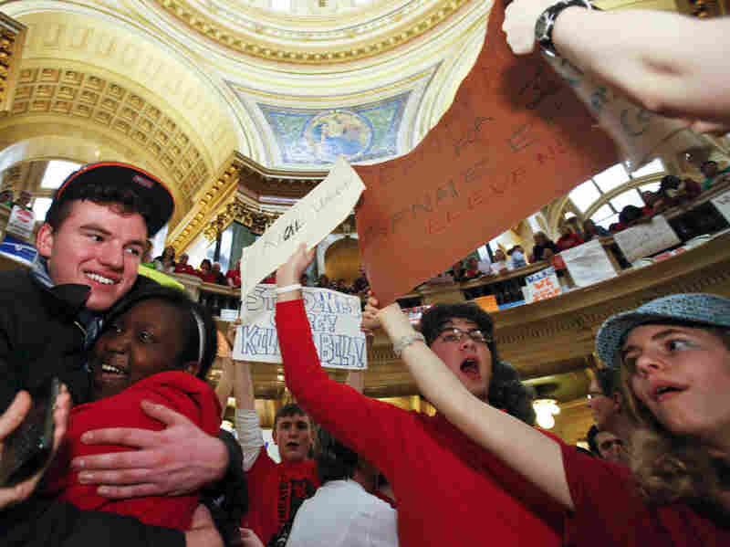 """Demonstrators chanting """"Kill the Bill!'' packed the Capitol rotunda in a show of force over the anti-union bill."""
